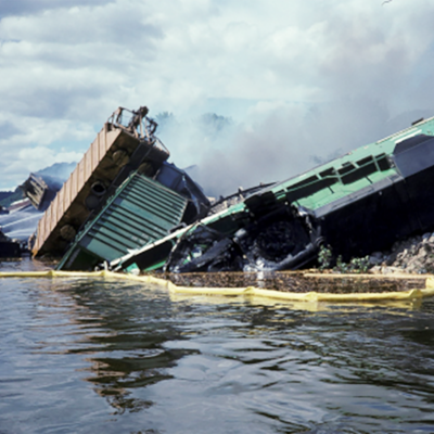 Image of a train derailment and spill into the Mississippi River